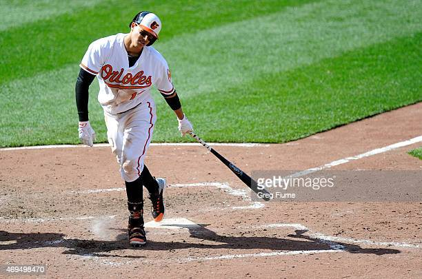 Manny Machado of the Baltimore Orioles reacts after striking out in the fifth inning against the Toronto Blue Jays at Oriole Park at Camden Yards on...