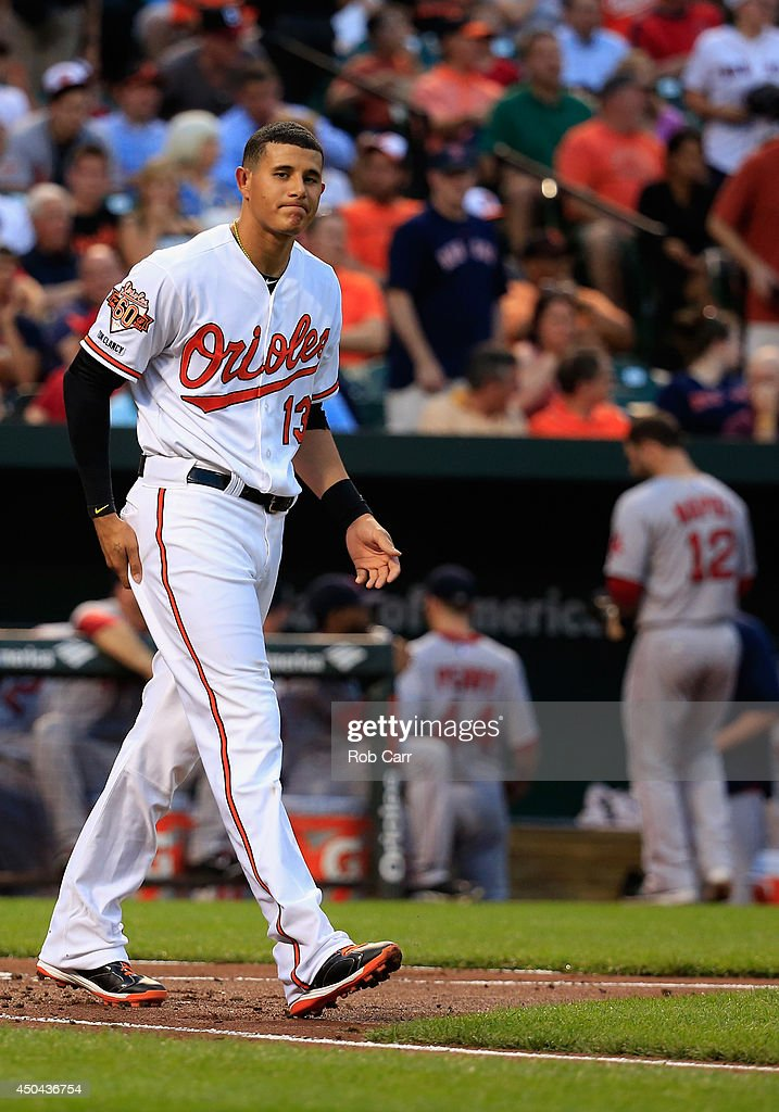 Manny Machado #13 of the Baltimore Orioles reacts after striking out against the Boston Red Sox at Oriole Park at Camden Yards on June 9, 2014 in Baltimore, Maryland.
