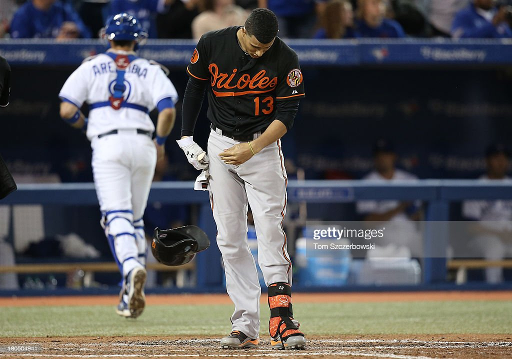 <a gi-track='captionPersonalityLinkClicked' href=/galleries/search?phrase=Manny+Machado&family=editorial&specificpeople=5591039 ng-click='$event.stopPropagation()'>Manny Machado</a> #13 of the Baltimore Orioles reacts after striking out to end the seventh inning during MLB game action against the Toronto Blue Jays on September 13, 2013 at Rogers Centre in Toronto, Ontario, Canada.