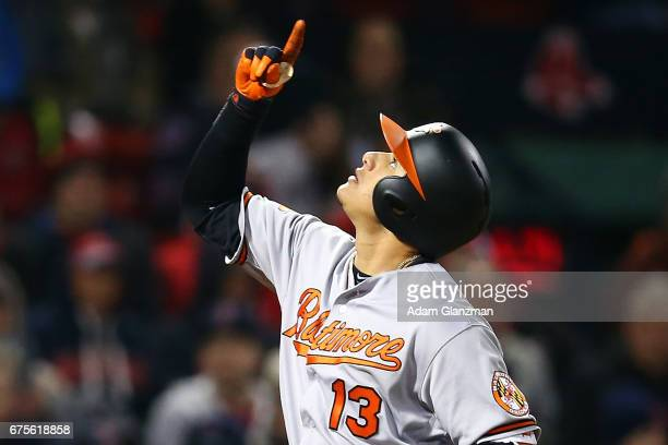Manny Machado of the Baltimore Orioles reacts as he crosses home plate after hitting a solo home run in the sixth inning of a game against the Boston...