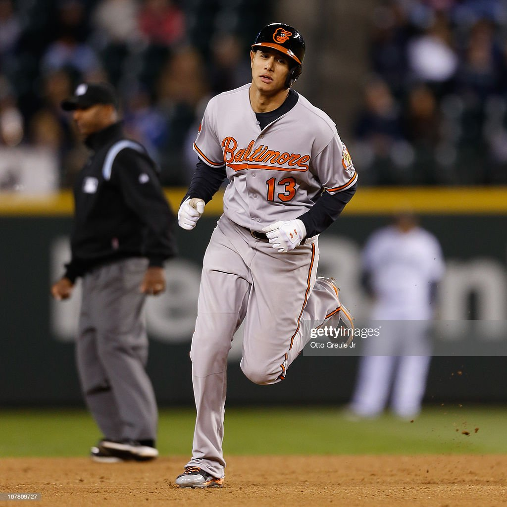 Manny Machado #13 of the Baltimore Orioles rounds the bases after hitting a solo home run in the eighth inning against the Seattle Mariners at Safeco Field on May 1, 2013 in Seattle, Washington.