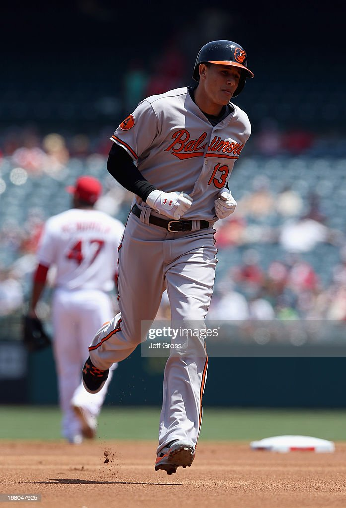 Manny Machado #13 of the Baltimore Orioles rounds the bases after hitting a solo home run in the first inning against the Los Angeles Angels of Anaheim at Angel Stadium of Anaheim on May 4, 2013 in Anaheim, California. The Orioles defeated the Angels 5-4 in ten innings.