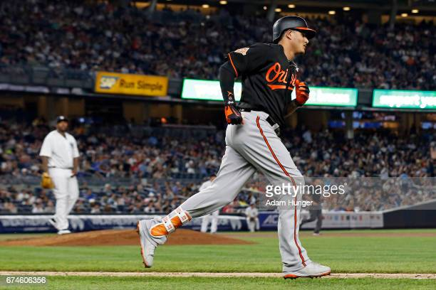 Manny Machado of the Baltimore Orioles rounds the bases after hitting a solo home run off of CC Sabathia of the New York Yankees during the fifth...