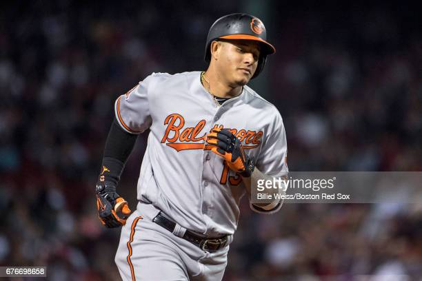 Manny Machado of the Baltimore Orioles rounds the bases after hitting a solo home run during the seventh inning of a game against the Boston Red Sox...