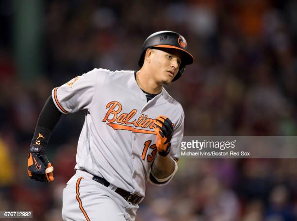 Manny Machado of the Baltimore Orioles rounds the bases after hitting a home run against the Boston Red Sox in the seventh inning at Fenway Park on...