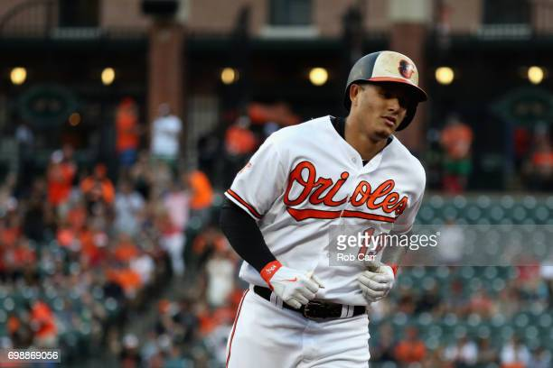 Manny Machado of the Baltimore Orioles rounds the bases after hitting a solo home run against the Cleveland Indians in the first inning at Oriole...