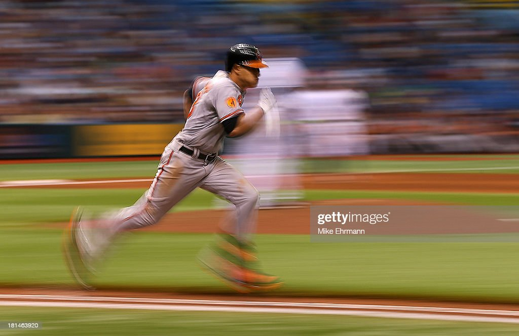 <a gi-track='captionPersonalityLinkClicked' href=/galleries/search?phrase=Manny+Machado&family=editorial&specificpeople=5591039 ng-click='$event.stopPropagation()'>Manny Machado</a> #13 of the Baltimore Orioles runs to first during a game against the Tampa Bay Rays at Tropicana Field on September 21, 2013 in St Petersburg, Florida.