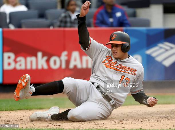 Manny Machado of the Baltimore Orioles slides home safely in the 11th inning against the New York Yankees on April 30 2017 at Yankee Stadium in the...