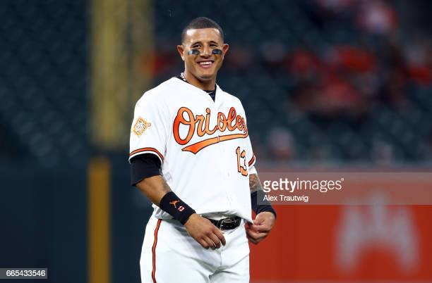 Manny Machado of the Baltimore Orioles smiles at the end of the firs tinning during the game against the Toronto Blue Jays at Oriole Park at Camden...