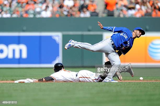 Manny Machado of the Baltimore Orioles steals second base in the second inning as the throw gets away from Devon Travis of the Toronto Blue Jays at...