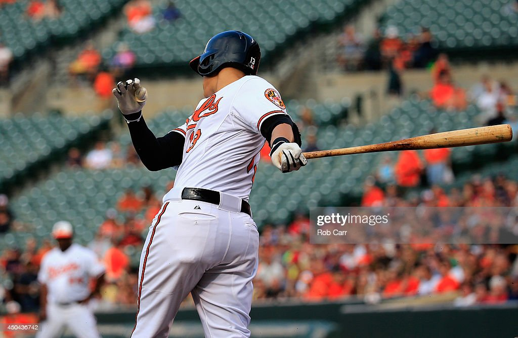 Manny Machado #13 of the Baltimore Orioles strikes out against the Boston Red Sox at Oriole Park at Camden Yards on June 9, 2014 in Baltimore, Maryland.