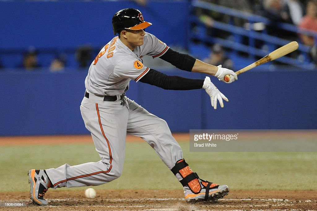 <a gi-track='captionPersonalityLinkClicked' href=/galleries/search?phrase=Manny+Machado&family=editorial&specificpeople=5591039 ng-click='$event.stopPropagation()'>Manny Machado</a> #13 of the Baltimore Orioles strikes out in the ninth inning during MLB game against the Toronto Blue Jays action September 15, 2013 at Rogers Centre in Toronto, Ontario, Canada.