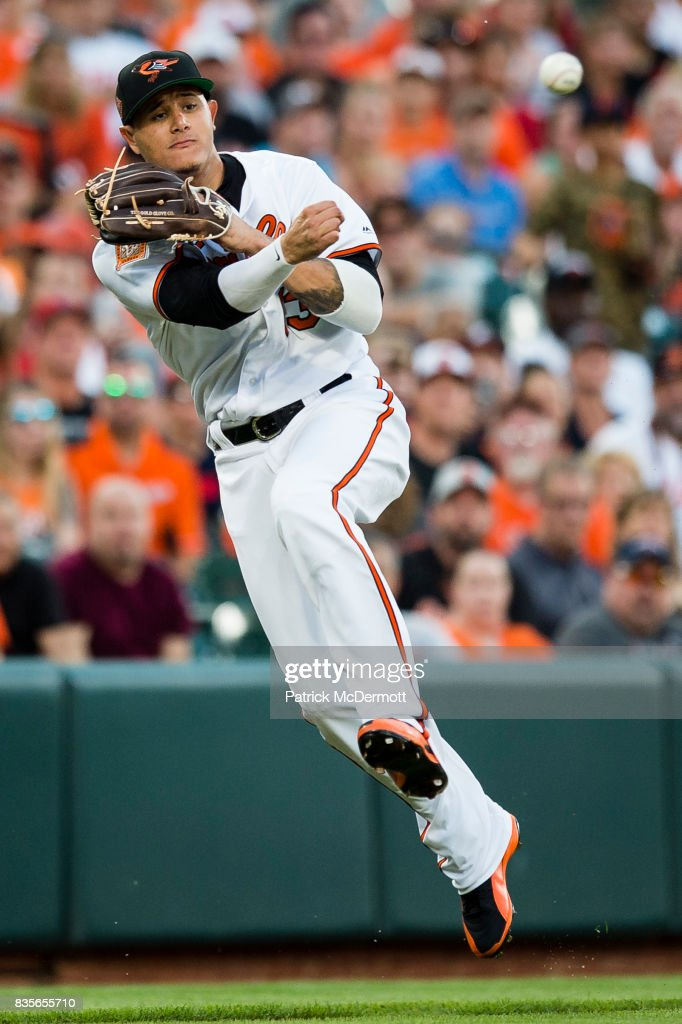 Manny Machado #13 of the Baltimore Orioles throws out Andrelton Simmons #2 of the Los Angeles Angels of Anaheim (not pictured) at first base on a ground ball in the first inning during a game at Oriole Park at Camden Yards on August 19, 2017 in Baltimore, Maryland.