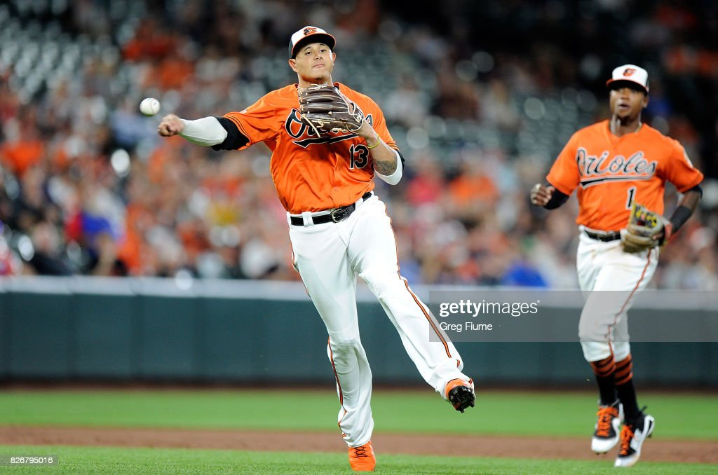 Manny Machado #13 of the Baltimore Orioles throws out Victor Martinez #41 (not pictured) of the Detroit Tigers in the ninth inning at Oriole Park at Camden Yards on August 5, 2017 in Baltimore, Maryland.