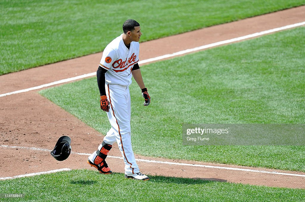 <a gi-track='captionPersonalityLinkClicked' href=/galleries/search?phrase=Manny+Machado&family=editorial&specificpeople=5591039 ng-click='$event.stopPropagation()'>Manny Machado</a> #13 of the Baltimore Orioles tosses his helmet after lining out to end the fifth inning against the Boston Red Sox at Oriole Park at Camden Yards on July 28, 2013 in Baltimore, Maryland.