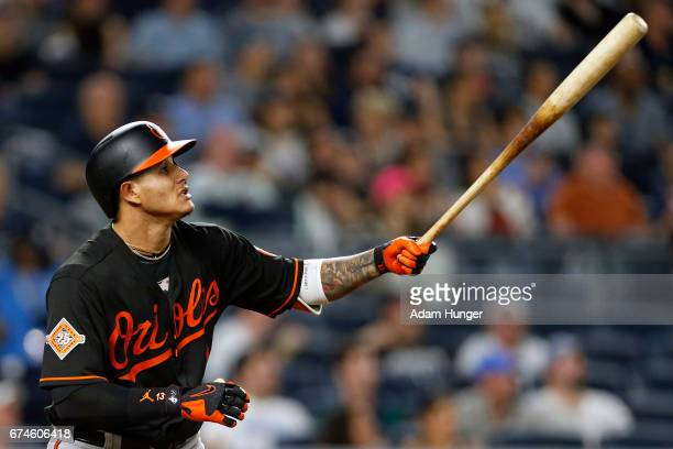 Manny Machado of the Baltimore Orioles watches a solo home run against the New York Yankees during the fifth inning at Yankee Stadium on April 28...