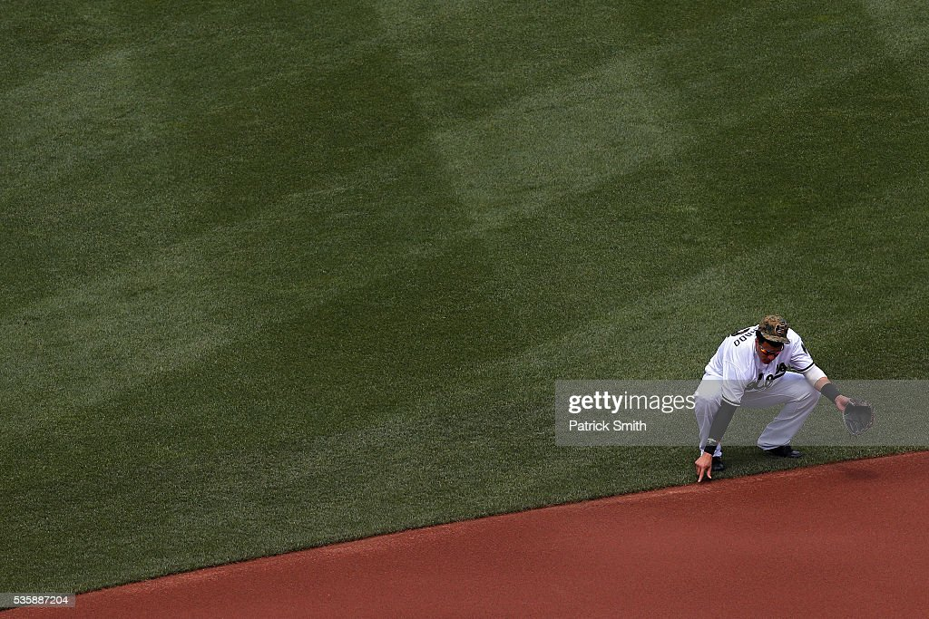 Manny Machado #13 of the Baltimore Orioles writes in the dirt before playing the Boston Red Sox at Oriole Park at Camden Yards on May 30, 2016 in Baltimore, Maryland.