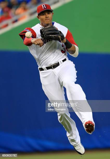 Manny Machado of the Dominican Republic makes a throw to first during a Pool C game of the 2017 World Baseball Classic against Canada at Miami...