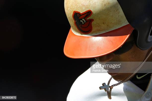 Manny Machado walks off of the field after being forced out at second base against the New York Yankees during the first inning at Oriole Park at...