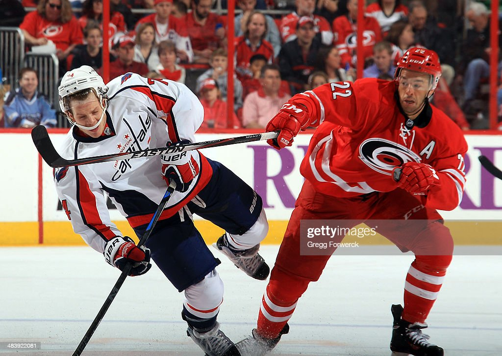 <a gi-track='captionPersonalityLinkClicked' href=/galleries/search?phrase=Manny+Malhotra&family=editorial&specificpeople=204479 ng-click='$event.stopPropagation()'>Manny Malhotra</a> #22 of the Carolina Hurricanes finishes a check on John Carlson #74 of the Washington Capitals during their NHL game at PNC Arena on April 10, 2014 in Raleigh, North Carolina.