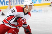 Manny Malhotra of the Carolina Hurricanes participates in warmups prior to an NHL game against the Tampa Bay Lightning at PNC Arena on November 1...