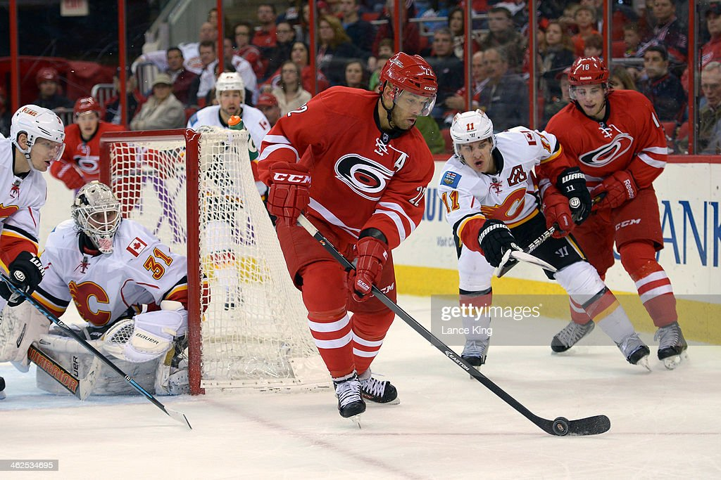 <a gi-track='captionPersonalityLinkClicked' href=/galleries/search?phrase=Manny+Malhotra&family=editorial&specificpeople=204479 ng-click='$event.stopPropagation()'>Manny Malhotra</a> #22 of the Carolina Hurricanes skates with the puck against the Calgary Flames at PNC Arena on January 13, 2014 in Raleigh, North Carolina. The Flames defeated the Hurricanes 2-0.