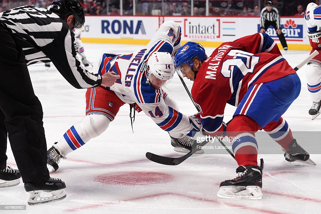 Manny Malhotra of the Montreal Canadiens and Chris Mueller of the New York Rangers prepares for a faceoff in the NHL game at the Bell Centre on...