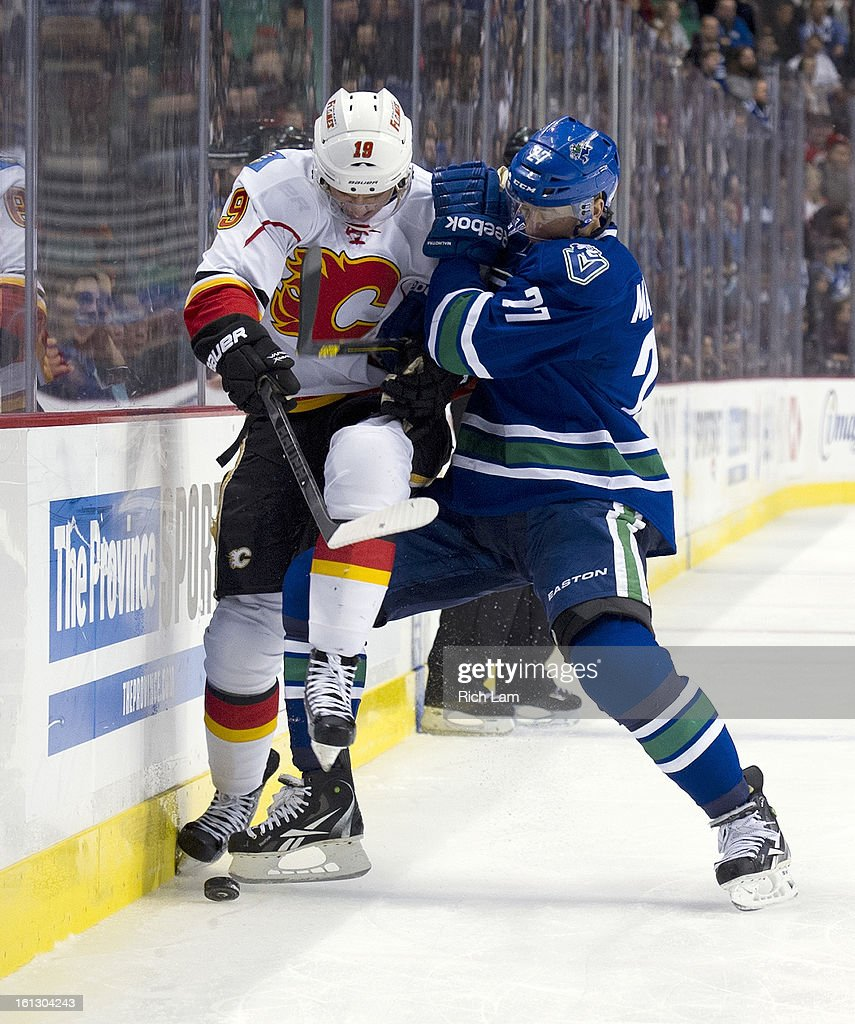 <a gi-track='captionPersonalityLinkClicked' href=/galleries/search?phrase=Manny+Malhotra&family=editorial&specificpeople=204479 ng-click='$event.stopPropagation()'>Manny Malhotra</a> #27 of the Vancouver Canucks checks Blair Jones #19 of the Calgary Flames into the the boards during the third period in NHL action on February 09, 2013 at Rogers Arena in Vancouver, British Columbia, Canada.