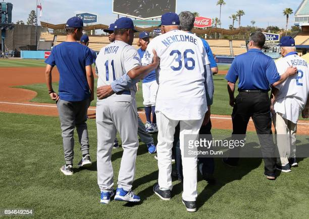 Manny Mota assists Don Newcombe as the the tow former Los Angeles Dodgers head out for a team photo before the Dodgers Old Timer's game at Dodger...