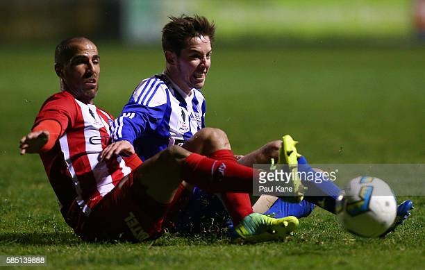Manny Muscat of Melbourne City and Jonathan Stynes of Floreat Athena contest for the ball during the FFA Cup Round of 32 match between Floreat Athena...
