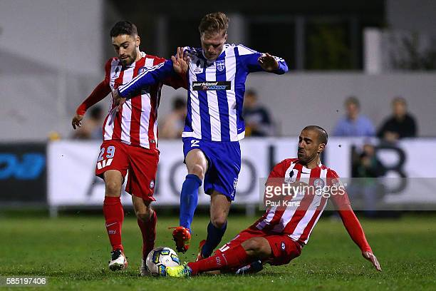 Manny Muscat of Melbourne City challenges Shaun Timmins of Floreat Athena during the FFA Cup Round of 32 match between Floreat Athena and Melbourne...