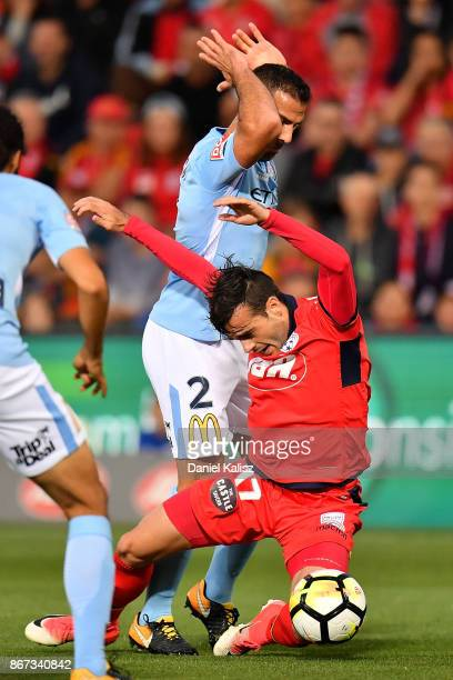 Manny Muscat of Melbourne City tackles Nikola Mileusnic of United during the round four ALeague match between Adelaide United and Melbourne City FC...