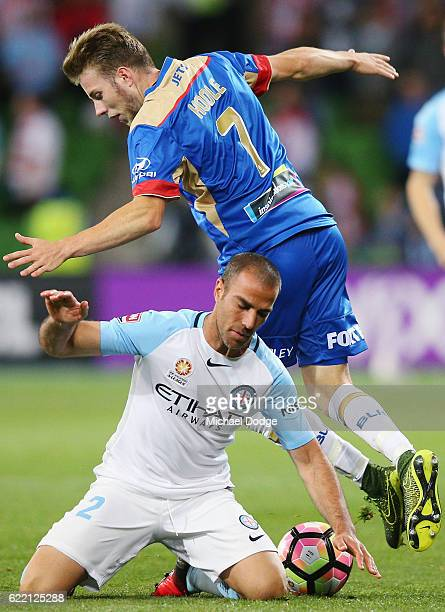 Manny Muscat of the City is tackled by Andrew Hoole of the Jetsduring the round six ALeague match between Melbourne City FC and Newcastle Jets at...