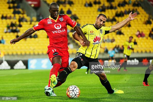 Manny Muscat of the Phoenix and Bruce Djite of Adelaide United compete for the ball during the round 22 ALeague match between the Wellington Phoenix...