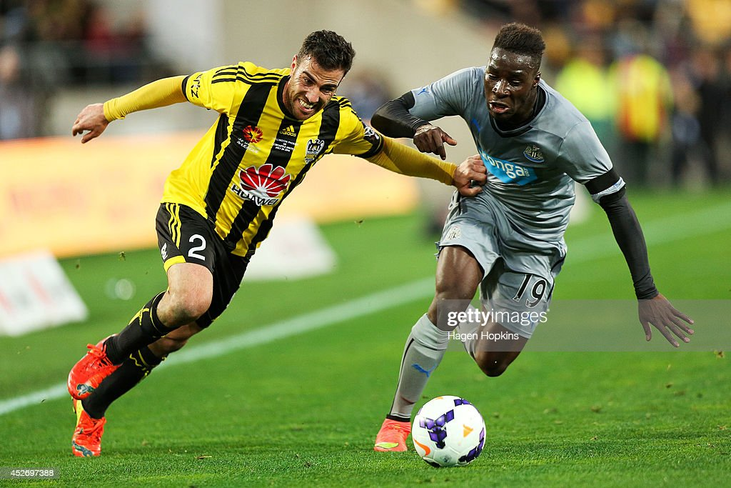 Manny Muscat of the Phoenix holds off Massadio Haidara of Newcastle United during the Football United New Zealand Tour 2014 match between the Wellington Phoenix and Newcastle United at Westpac Stadium on July 26, 2014 in Wellington, New Zealand.