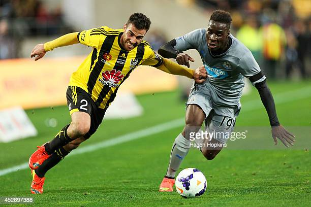 Manny Muscat of the Phoenix holds off Massadio Haidara of Newcastle United during the Football United New Zealand Tour 2014 match between the...