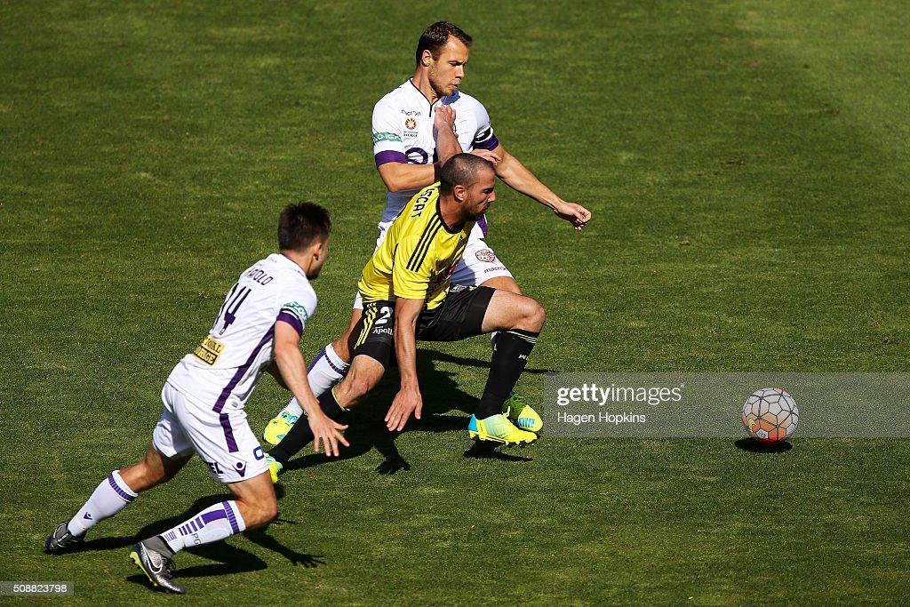Manny Muscat of the Phoenix holds off the challenge of Chris Harold and Krisztian Vadocz of the Glory during the round 18 A-League match between Wellington Phoenix and Perth Glory at Westpac Stadium on February 7, 2016 in Wellington, New Zealand.