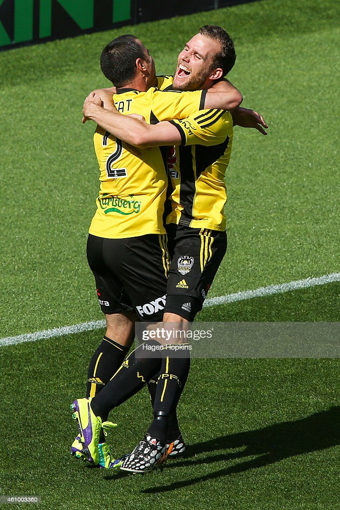 Manny Muscat (L) of the Phoenix is congratulted on his goal by teammate <a gi-track='captionPersonalityLinkClicked' href=/galleries/search?phrase=Jeremy+Brockie&family=editorial&specificpeople=591299 ng-click='$event.stopPropagation()'>Jeremy Brockie</a> during the round 15 A-League match between the Wellington Phoenix and Brisbane Roar at Westpac Stadium on January 4, 2015 in Wellington, New Zealand.