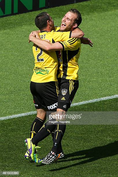 Manny Muscat of the Phoenix is congratulted on his goal by teammate Jeremy Brockie during the round 15 ALeague match between the Wellington Phoenix...