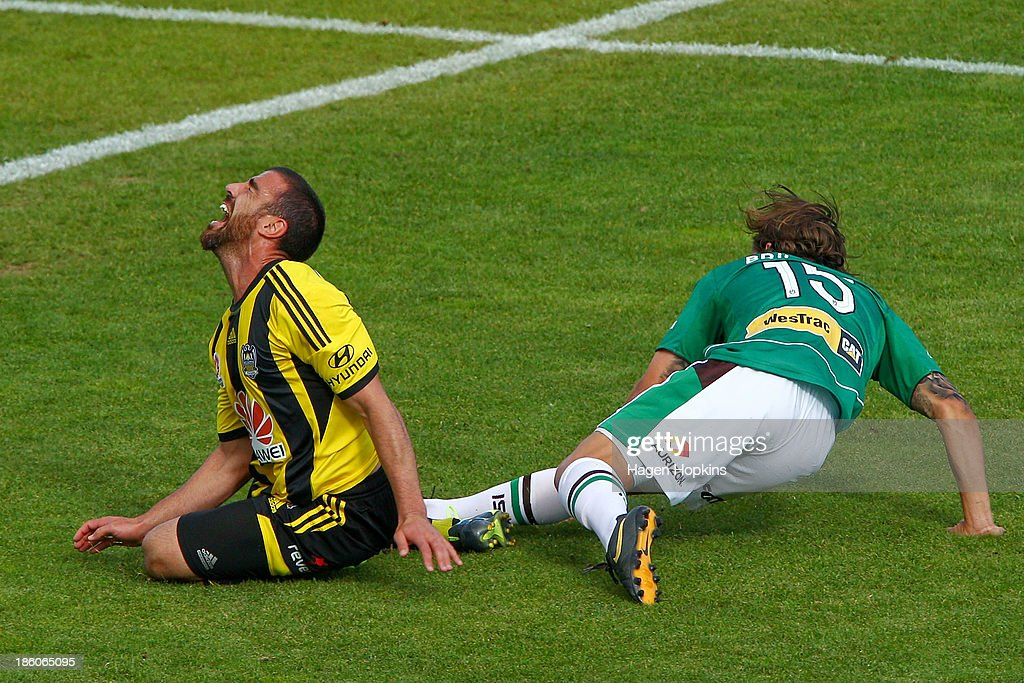 Manny Muscat of the Phoenix is tackled by Josh Brillante of the Jets during the round three A-League match between Wellington Phoenix and the Newcastle Jets at McLean Park on October 27, 2013 in Napier, New Zealand.