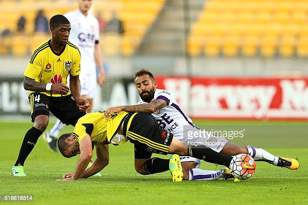 Manny Muscat of the Phoenix loses his footing in the challenge of Diego Castro of the Glory while Roly Bonevacia of the Phoenix looks on during the...
