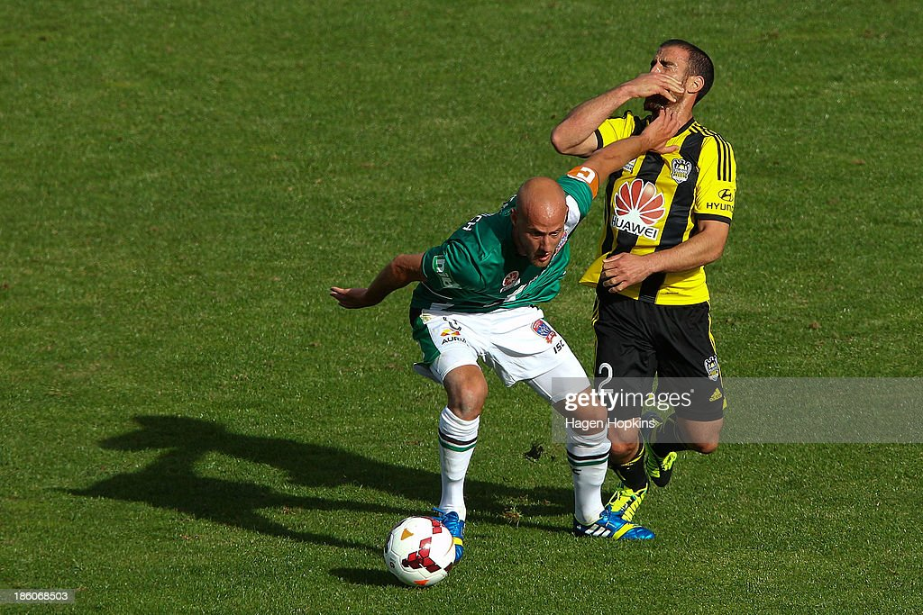 Manny Muscat of the Phoenix reacts after colliding with <a gi-track='captionPersonalityLinkClicked' href=/galleries/search?phrase=Ruben+Zadkovich&family=editorial&specificpeople=791211 ng-click='$event.stopPropagation()'>Ruben Zadkovich</a> of the Jets during the round three A-League match between Wellington Phoenix and the Newcastle Jets at McLean Park on October 27, 2013 in Napier, New Zealand.
