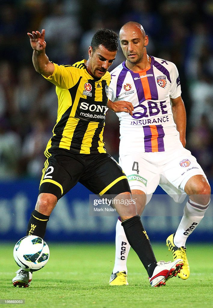 Manny Muscat of Wellington and Billy Mehmet of Perth contest possession during the round eight A-League match between Perth Glory and Wellington Phoenix at NIB Stadium on November 24, 2012 in Perth, Australia.