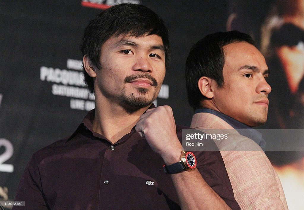 <a gi-track='captionPersonalityLinkClicked' href=/galleries/search?phrase=Manny+Pacquiao&family=editorial&specificpeople=3855506 ng-click='$event.stopPropagation()'>Manny Pacquiao</a> and <a gi-track='captionPersonalityLinkClicked' href=/galleries/search?phrase=Juan+Manuel+Marquez&family=editorial&specificpeople=4202669 ng-click='$event.stopPropagation()'>Juan Manuel Marquez</a> attend the Pacquio v Marquez III Boxing Press Conference at The Lighthouse at Pier 61 at Chelsea Piers on September 6, 2011 in New York City.