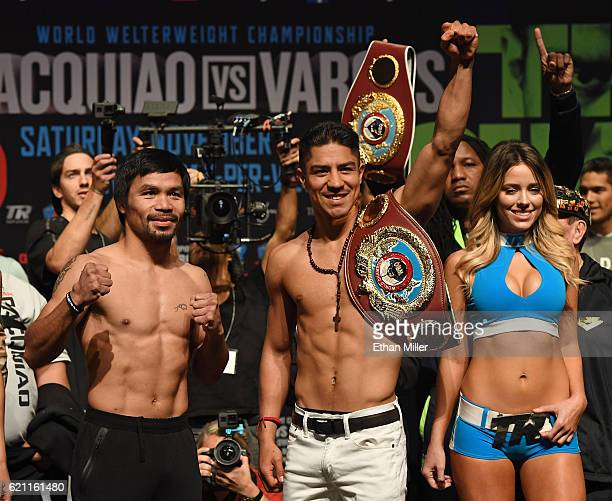 Manny Pacquiao and WBO welterweight champion Jessie Vargas pose during their official weighin at the Encore Theater at Wynn Las Vegas on November 4...