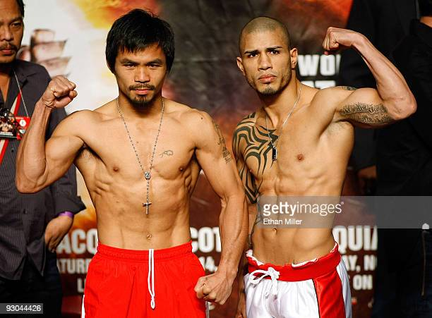 Manny Pacquiao and WBO welterweight champion Miguel Cotto stand next to each other during the weighin for their bout at the MGM Grand Garden Arena on...
