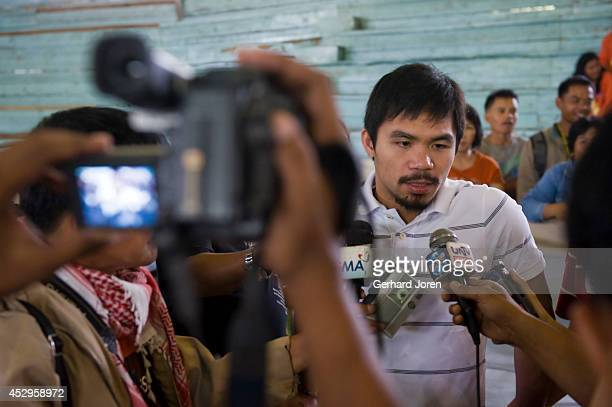 MALUNGON MINDANAO PHILIPPINES Manny Pacquiao being interviewed by the press at an event in Malungon where he donated 81 hospital beds to the province...