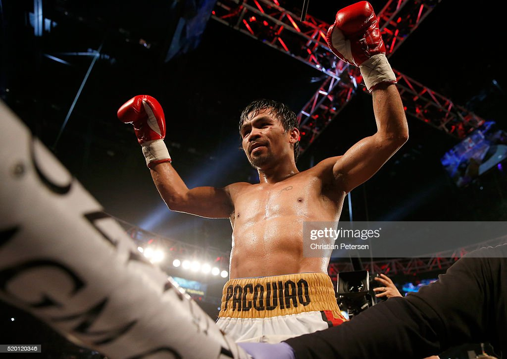<a gi-track='captionPersonalityLinkClicked' href=/galleries/search?phrase=Manny+Pacquiao&family=editorial&specificpeople=3855506 ng-click='$event.stopPropagation()'>Manny Pacquiao</a> celebrates after defeating Timothy Bradley Jr. by unanimous decision in their welterweight championship fight on April 9, 2016 at MGM Grand Garden Arena in Las Vegas, Nevada.