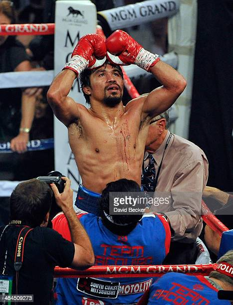 Manny Pacquiao celebrates after his unanimous decision victory over Timothy Bradley during their WBO world welterweight championship boxing match at...