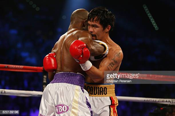 Manny Pacquiao clinches up against Timothy Bradley Jr during their welterweight championship fight on April 9 2016 at MGM Grand Garden Arena in Las...